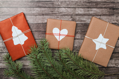 Christmas gifts with fir-tree on wooden background. Flat lay, top view. 版權商用圖片