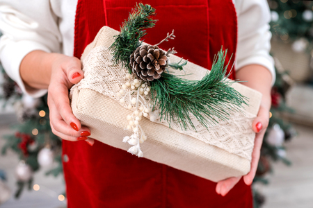 Christmas gift box in womans hands. Close-up. Merry Christmas and Happy New year.