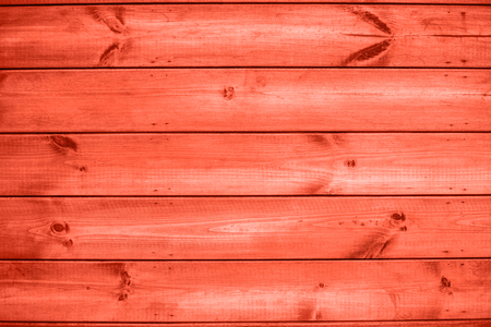 Wooden plank coral colour wall outdoors. Natural wooden background.