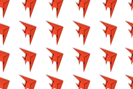 Pattern of red paper origami fishes isolated on white background. Stockfoto
