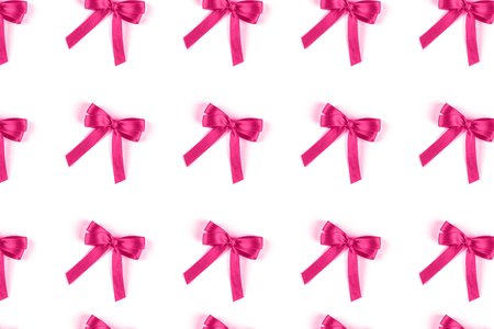 Pink silk gift bow isolated on white background. Festive concept.