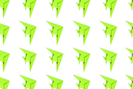 Pattern of neon paper origami fishes isolated on white background. Stock Photo