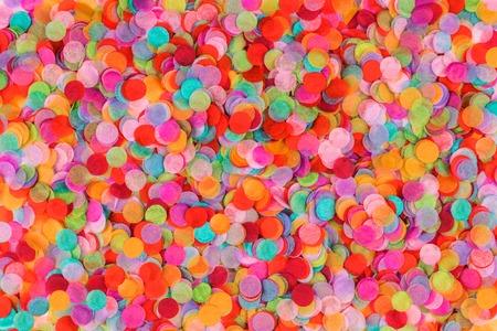Multicolored confetti background. Flat lay style. Festive concept