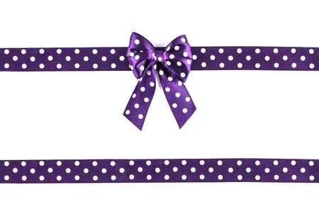 Shiny purple silk ribbon isolated on white background. Festive concept. Flat lay.