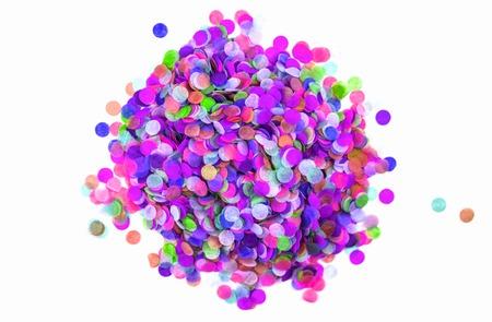 Heap of festive round paper multicolored confetti isolated on white. Festive concept.