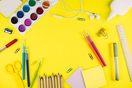 Different school supplies on bright yellow paper background. Back to school background. Flat lay, copy space. Imagens - 124895025