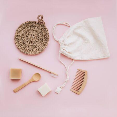 Zero waste set for bathing on light pink background. Flat lay style.