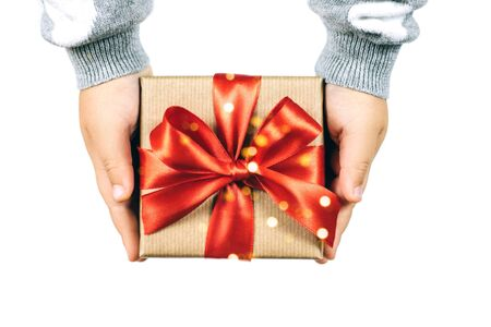 Christmas gift in childs hands isolated on white background. Festive concept. Stockfoto