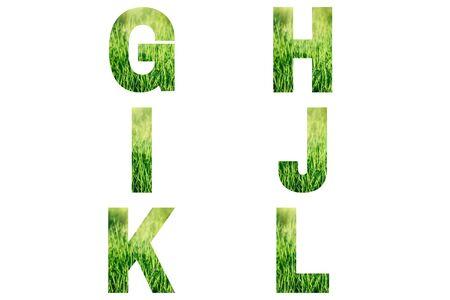 Green font Alphabet g, h, i, j, k, l made of fresh green grass background.