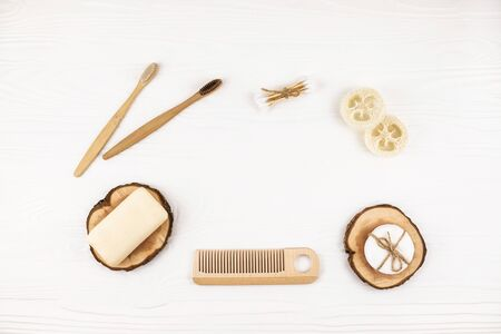 Set of eco natural bathroom accessories on white wooden background. Zero waste concept. Plastic free. Flat lay style. Stock fotó