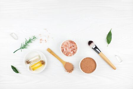 Homemade spa cosmetic set with salt and oil on white wooden background. Copy space. Flat lay style. Stock fotó