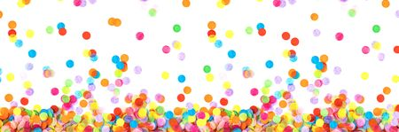 Banner made from bright multicolored confetti isolated on a white background. Festive concept. Childrens party, birthday, wedding, celebration. Top view. Copy space. Stock fotó