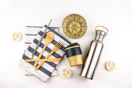 Eco set with bamboo cutlery, reusable coffee mug and water bottle with kitchen towels on white background. Sustainable lifestyle. Zero waste and plastic free concept. Stock fotó