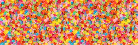 Banner made from bright multicolored confetti. Festive concept. Childrens party, birthday, wedding, celebration. Top view. Copy space.