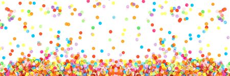 Banner made from bright multicolored confetti isolated on a white background. Festive concept. Childrens party, birthday, wedding, celebration. Top view. Copy space. 免版税图像
