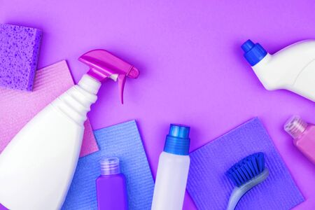 House cleaning products are on purple background. Cleaning concept.