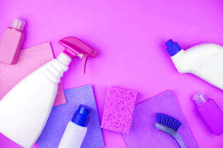 House cleaning products are on purple background. Cleaning concept. Stockfoto