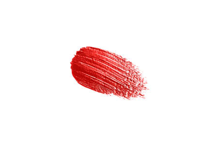 Red concealer swatch isolated on white background. Make up.