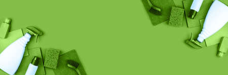 Banner made from house cleaning products are on green background. Cleaning concept.