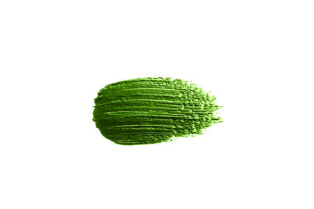 Green concealer swatch isolated on white background. Make up.
