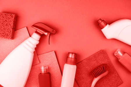 House cleaning products are on red background. Cleaning concept.