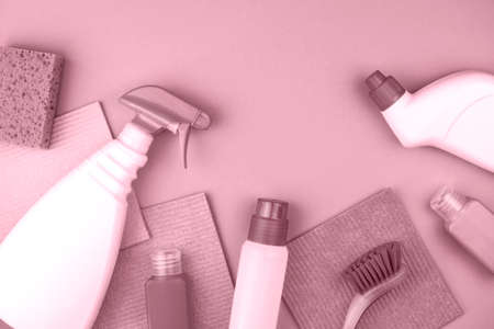 House cleaning products are on pink background. Cleaning concept.