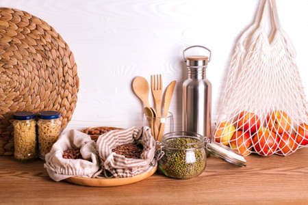 Variety of grains and legumes in glass jars and eco bags. No waste storage concept