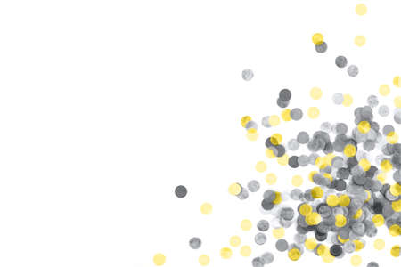 Bright yellow anf gray confetti isolated on a white background. Top view. Copy space.
