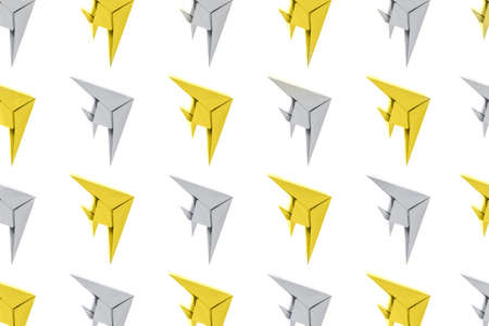 Pattern of paper origami yellow and gray fishes isolated on white background. Leadership and business concept.