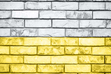 Gray and yellow brick wall texture background. Trend color concept. Imagens