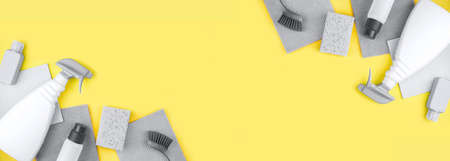 Banner made from grey house cleaning products are on yellow background. Cleaning concept.