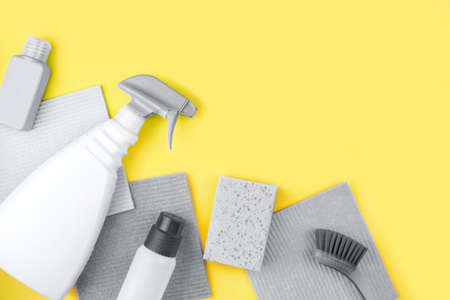 House cleaning products are on yellow background. Cleaning concept.