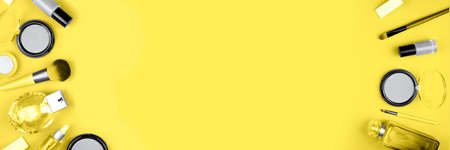Banner made from set of decorative cosmetics for make up on yellow