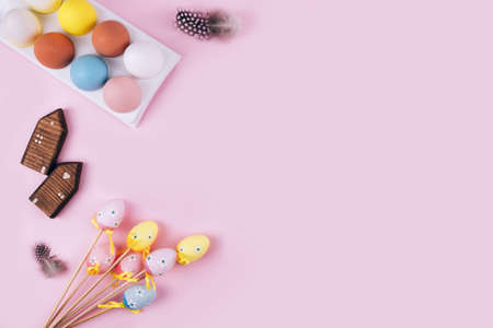 Colorful Easter eggs over pink background. Top view with copy space Imagens
