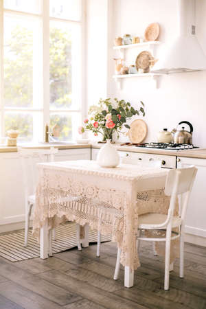 Light modern kitchen in cozy house. Home interior.