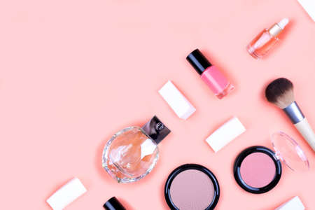 Set of decorative cosmetics for make up on pink background. Copy space, flat lay.