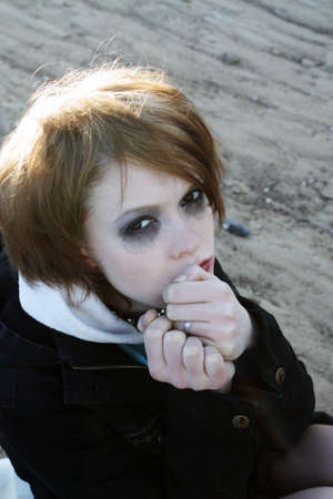 The tear-stained girl with the begun to flow ink looks in the camera. photo