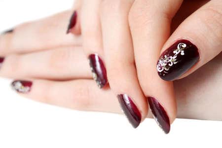 polish girl: Close-up of manicure is isolated on white background.