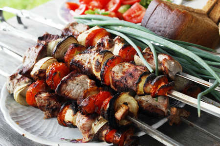 broiling: Skewers with a shish kebab Stock Photo