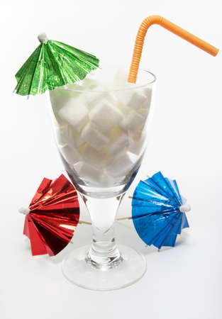 Unhealthy drink with sugar cubes on white background photo