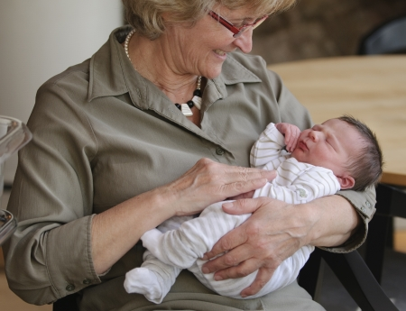 Happy grandma with newborn baby Stock Photo - 12455649