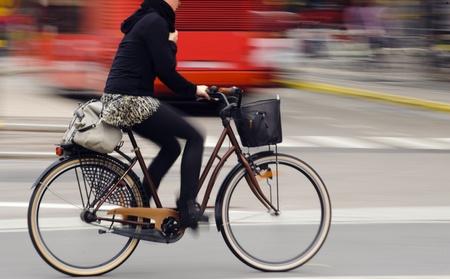 Motion blurred female biker photo