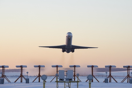 An airplane taking off on a cold winters evening  Stock Photo