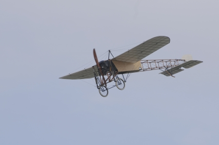 monoplane: Vintage aircraft Bleriot XI in the air