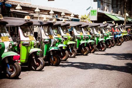 BANGKOK THAILAND  21 APR 2015: Thailand traditional triwheels Taxi  Tuk tuk  lined up in a side ally in Bangkok