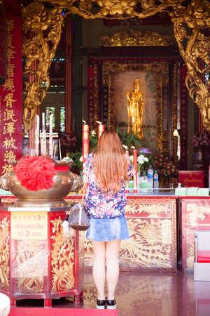 worshipper: Bangkok  2015 April 21: Worshipper women pray inside Guanyin Temple in Yaowaraj Road China town Thailand.