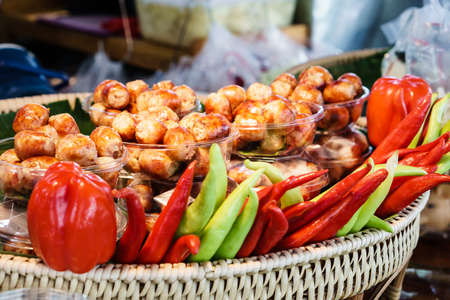 northeastern: Thai style grilled sausage, also call Sai krok isan or Northeastern Style Sausage with Chilli suitable for background use Stock Photo