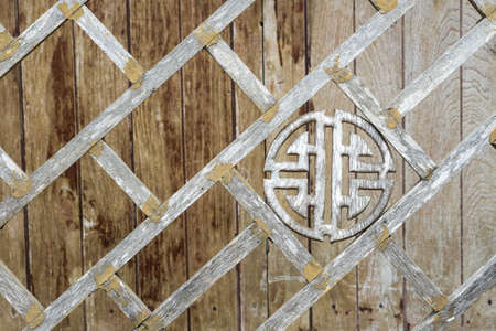 The antique chinese style wooden fence in Thailand