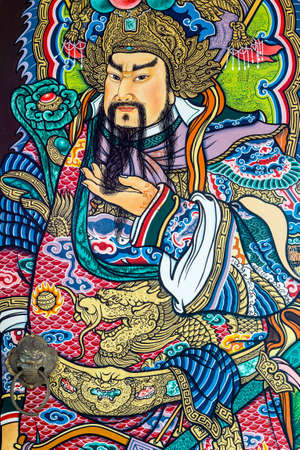Guan Yu deva [God of honor] paint fine art on the door of chinese temple in Thailand