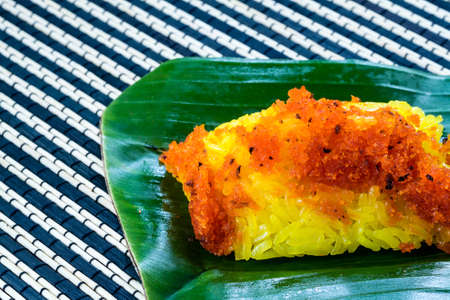 shred: Red shrimp and shred coconut on yellow sticky rice. Thai style sweet dessert.